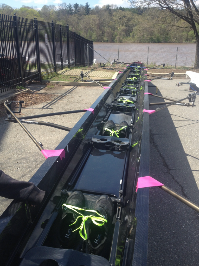 This is an photograph of rowing splash guards on a Resolute Racing shell