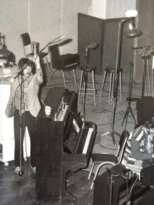 Paul McCartney moving his microphone
