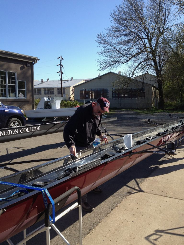 working on boat in rowing shell slings