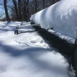 This is photograph of rowing shell in snow