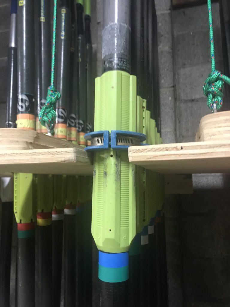 This is a picture of oars supported in an oar rack