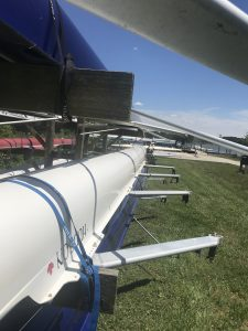 This is a picture of rowing shells on rowing shell racks