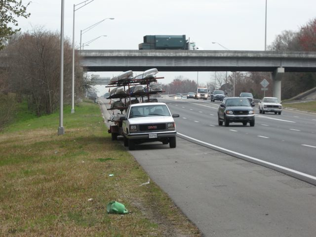 This is a picture of a rowing shell trailer broken down on the side of the interstate